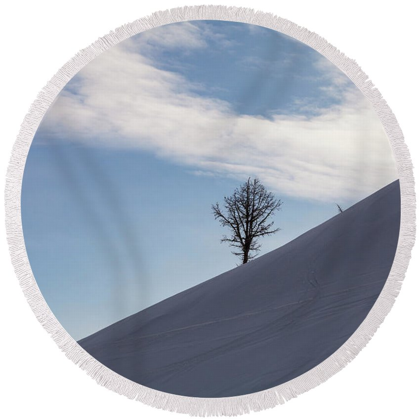 Adventure Round Beach Towel featuring the photograph A Backcountry Skier Skins Up A Ridge by Robin Carleton