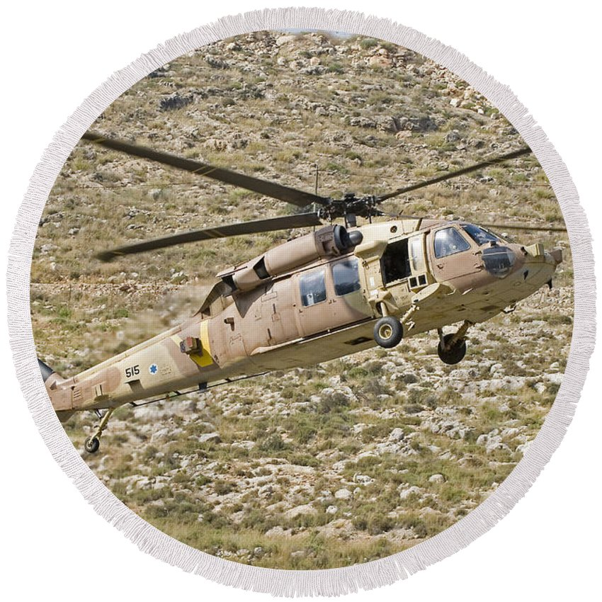 Transportation Round Beach Towel featuring the photograph A Uh-60l Yanshuf Helicopter by Ofer Zidon