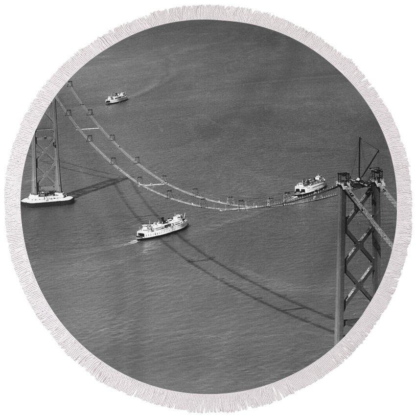 1935 Round Beach Towel featuring the photograph Bay Bridge Under Construction by Charles Hiller