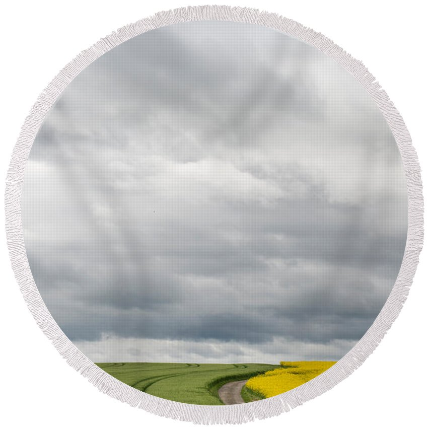 Photography Round Beach Towel featuring the photograph Dirt Road Passing Through Grain by Panoramic Images