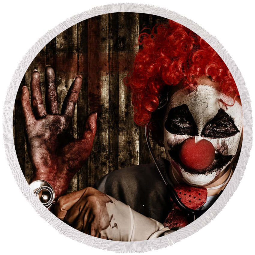 Clown Round Beach Towel featuring the photograph Frightening Clown Doctor Holding Amputated Hand by Jorgo Photography - Wall Art Gallery