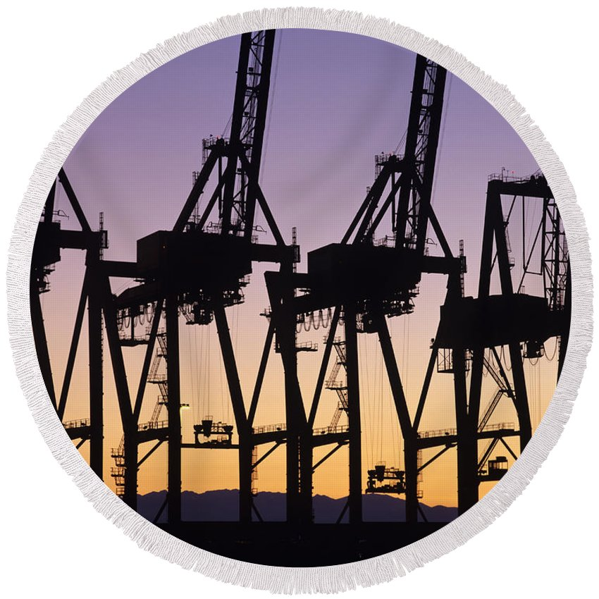Load Round Beach Towel featuring the photograph Port Of Seattle Cranes Silhouetted by Jim Corwin