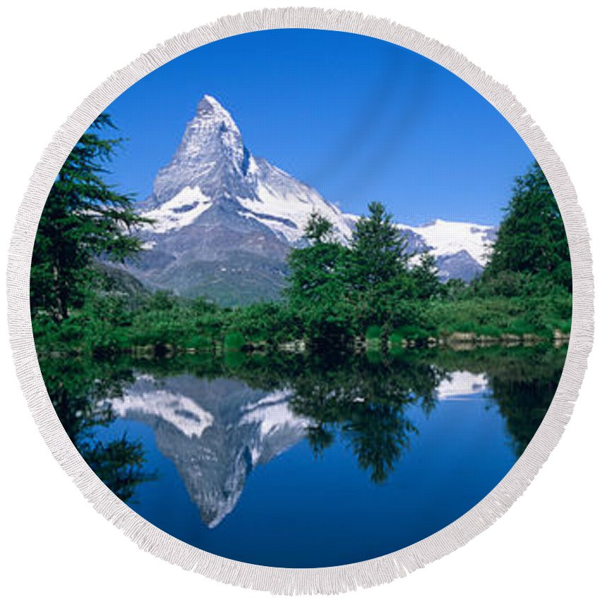 Photography Round Beach Towel featuring the photograph Reflection Of A Snow Covered Mountain by Panoramic Images
