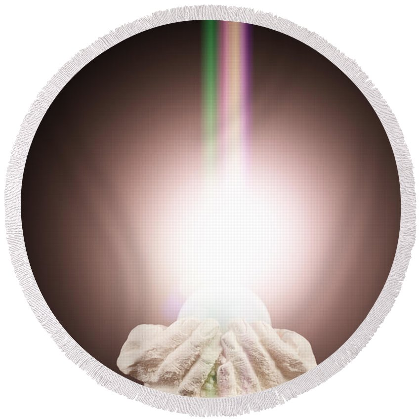Spiritual Round Beach Towel featuring the photograph Spiritual Light In Cupped Hands On A Black Background by Simon Bratt Photography LRPS