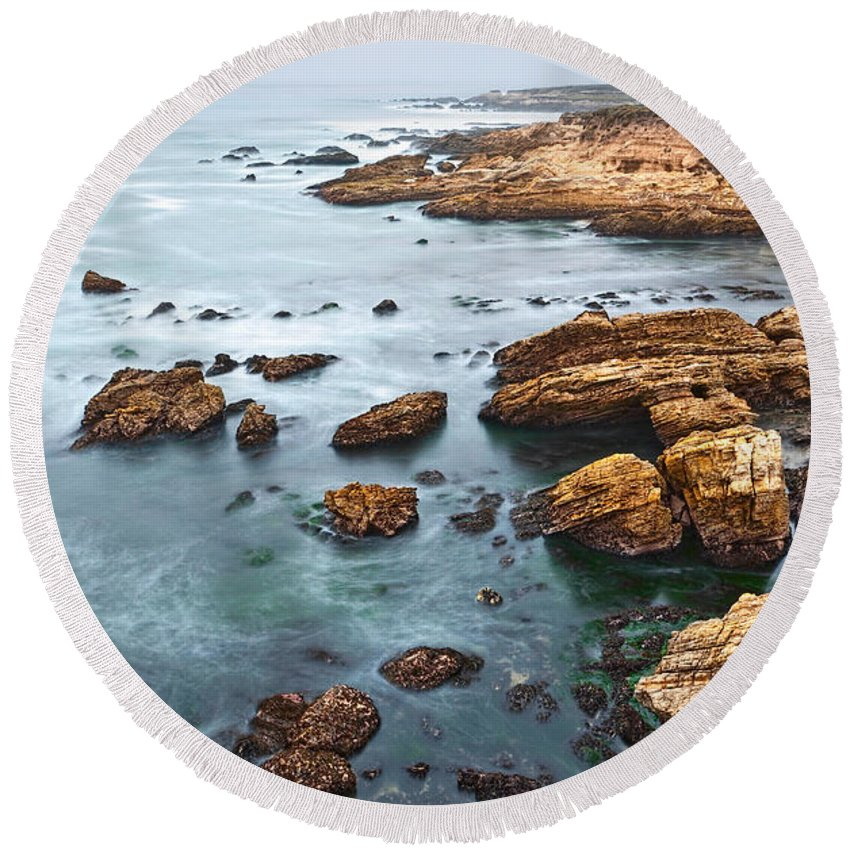 Montana De Oro Round Beach Towel featuring the photograph The Jagged Rocks And Cliffs Of Montana De Oro State Park In California by Jamie Pham