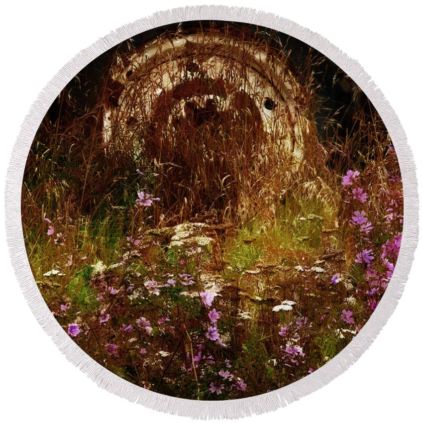 Building; Canterbury; Christchurch; Corrugated; Farm; Flora; Flower; Grass; Iron; New Zealand; Nz; Plant; South Island; Weeds; Rust Round Beach Towel featuring the photograph The Spare Wheel by Steve Taylor