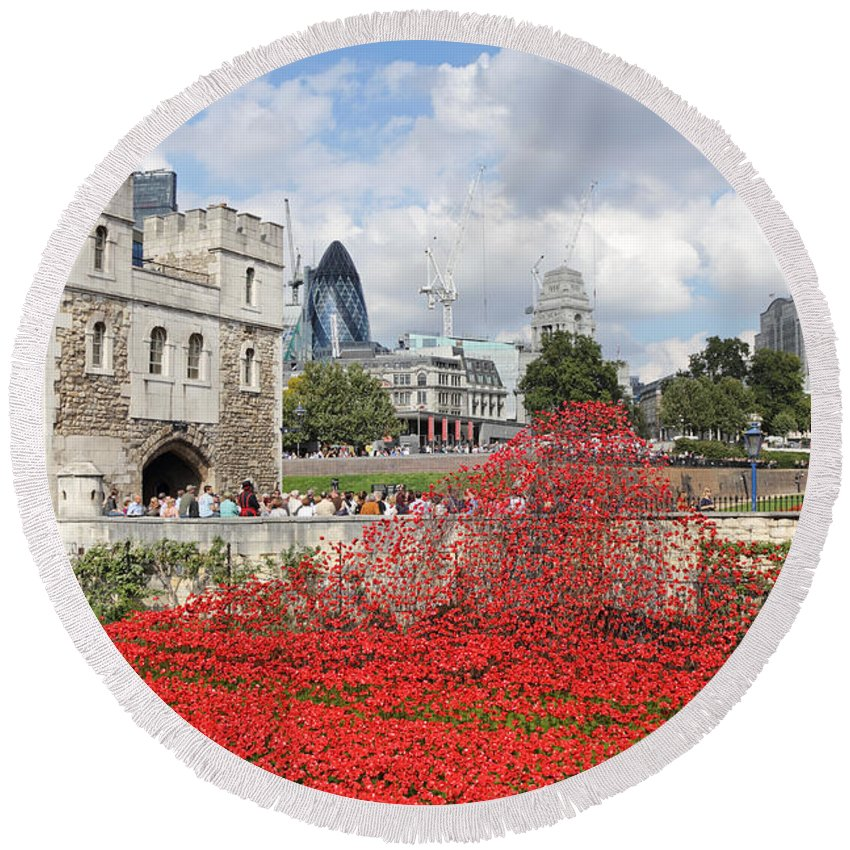 Remembrance Poppies At The Tower Of London Round Beach Towel featuring the photograph Remembrance Poppies At The Tower Of London by Julia Gavin