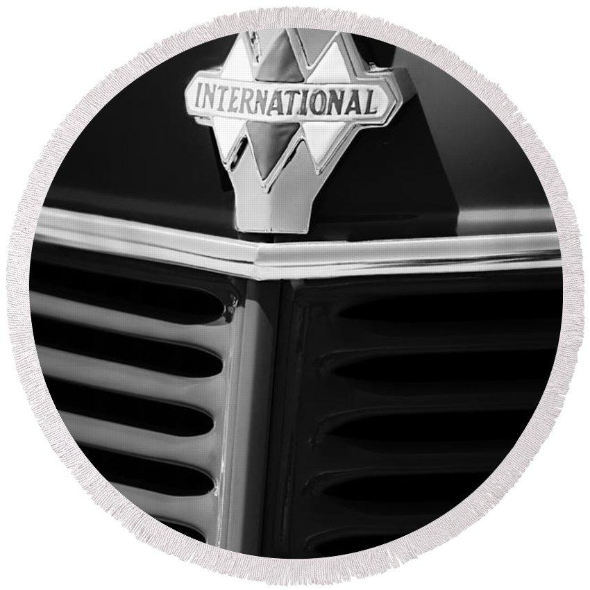 1937 International D2 Pickup Truck Grille Emblem Round Beach Towel featuring the photograph 1937 International D2 Pickup Truck Grille Emblem by Jill Reger