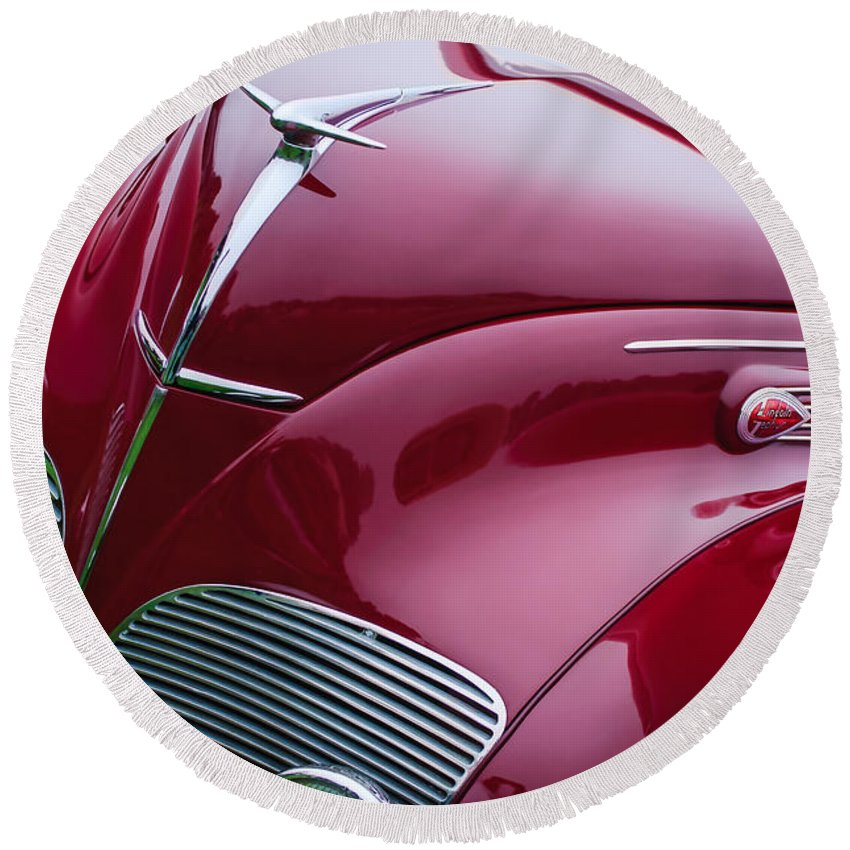 1938 Lincoln-zephyr Convertible Coupe Grille Round Beach Towel featuring the photograph 1938 Lincoln-zephyr Convertible Coupe Grille - Hood Ornament - Emblem by Jill Reger