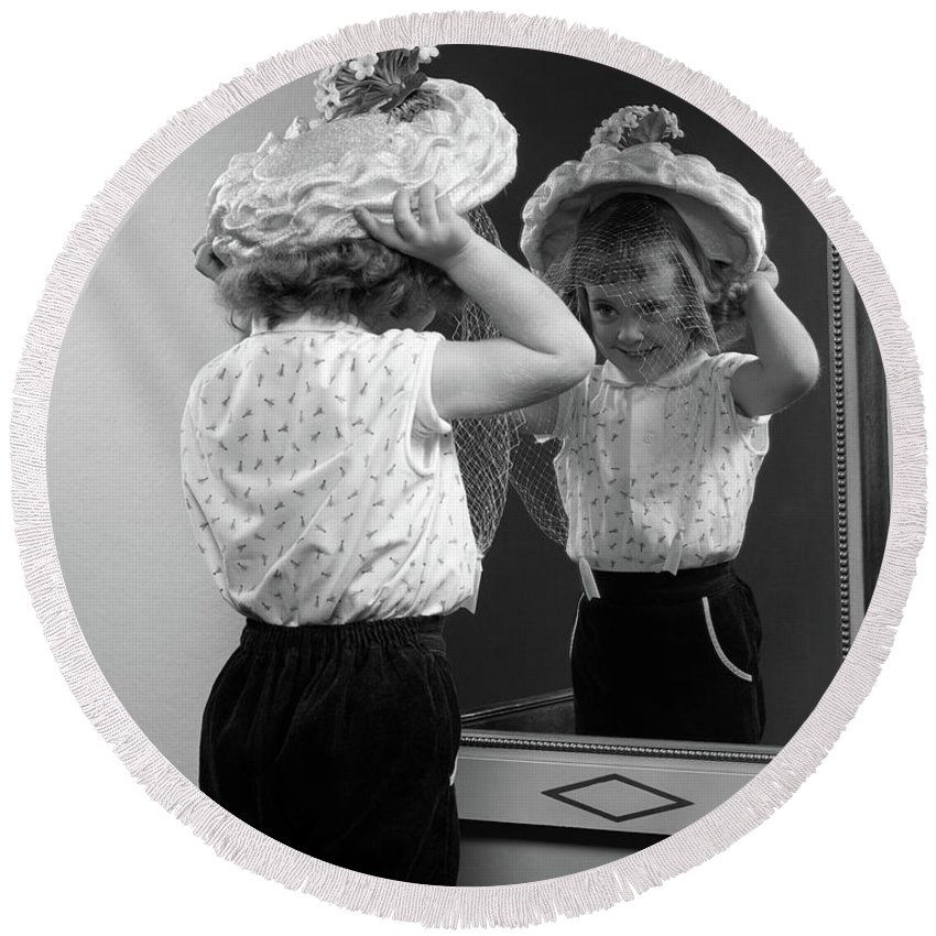 Photography Round Beach Towel featuring the photograph 1950s Little Girl Trying On Hat Looking by Vintage Images
