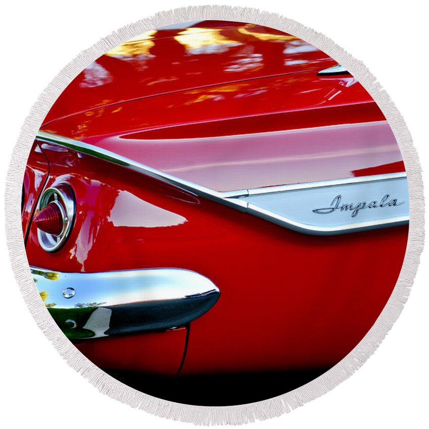 1961 Chevrolet Impala Round Beach Towel featuring the photograph 1961 Chevrolet Impala Taillight Emblem by Jill Reger