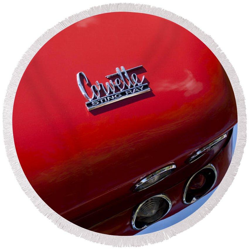 1967 Chevrolet Corvette Round Beach Towel featuring the photograph 1967 Chevrolet Corvette Taillight Emblem by Jill Reger