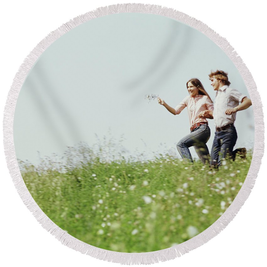 Photography Round Beach Towel featuring the photograph 1970s Boy Girl Running Field by Vintage Images