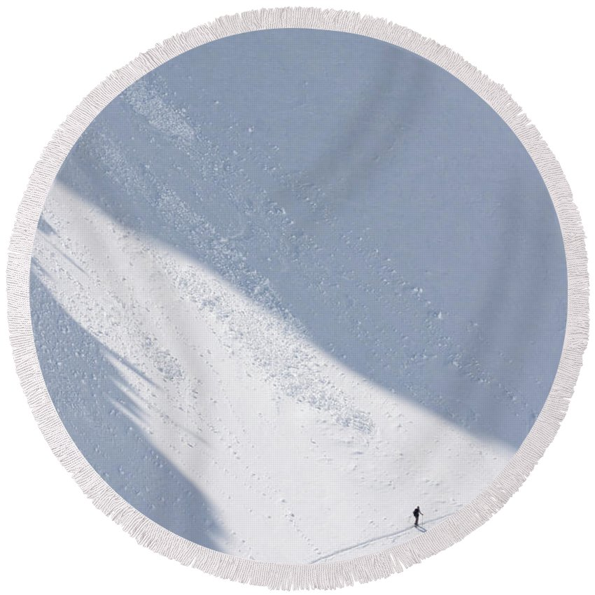 Adventure Round Beach Towel featuring the photograph A Backcountry Skier In The Sawtooth by Craig Moore