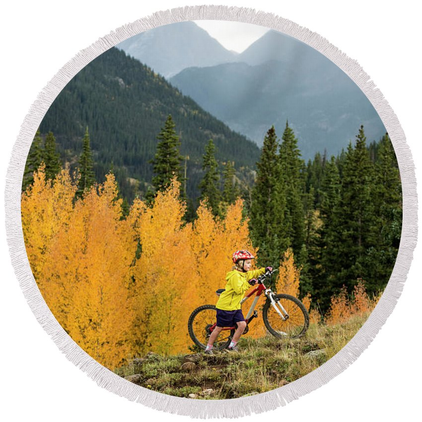 Forest Round Beach Towel featuring the photograph A Young Girl Mountain Biking In The San by Kennan Harvey