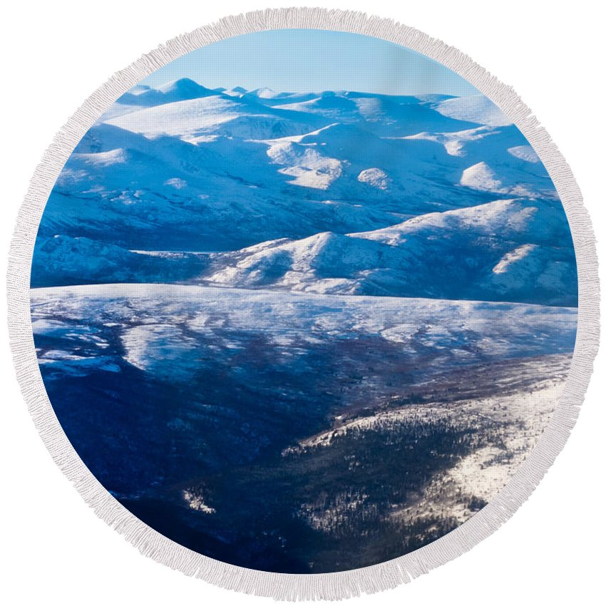 Aerial Round Beach Towel featuring the photograph Aerial View Of Snowcapped Peaks In Bc Canada by Stephan Pietzko