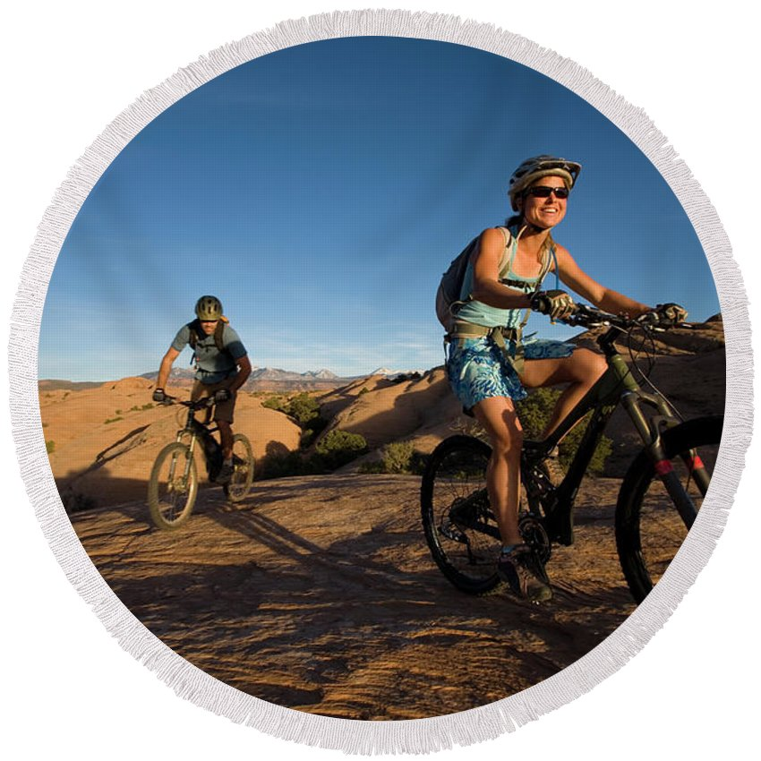 20-25 Years Round Beach Towel featuring the photograph Couple Mountain Biking, Moab, Utah by Whit Richardson