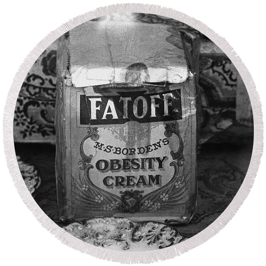 Fatoff Obesity Cream Bottled Electricity Store Window Ghost Town Virginia City Montana 1971 Round Beach Towel featuring the photograph Fatoff Obesity Cream Bottled Electricity Store Window Ghost Town Virginia City Montana 1971 by David Lee Guss