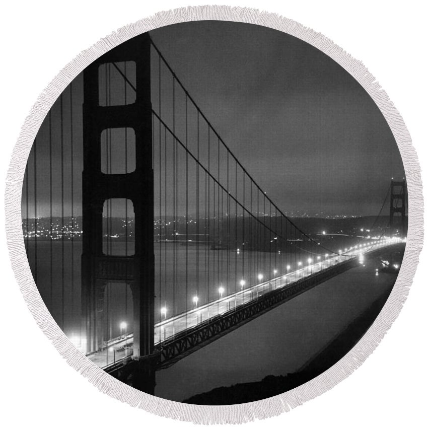 1937 Round Beach Towel featuring the photograph Golden Gate Bridge At Night by Underwood Archives