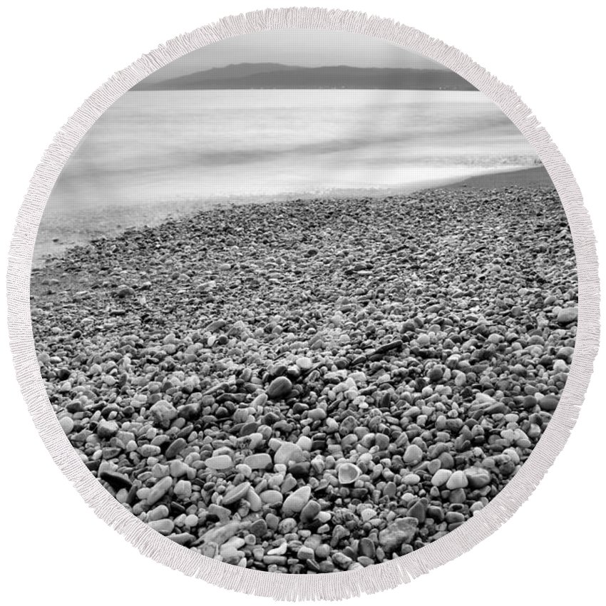 Black And White Round Beach Towel featuring the photograph Little Stones At The Silver Sea by Guido Montanes Castillo