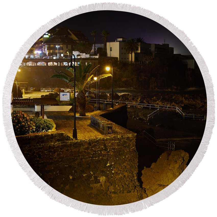 Atlantic Ocean Round Beach Towel featuring the photograph Puerto De La Cruz By Night by Jouko Lehto