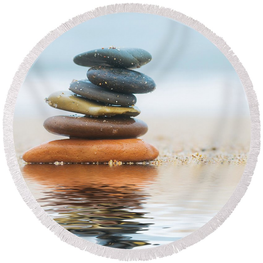 Stone Round Beach Towel featuring the photograph Stack Of Beach Stones On Sand by Michal Bednarek