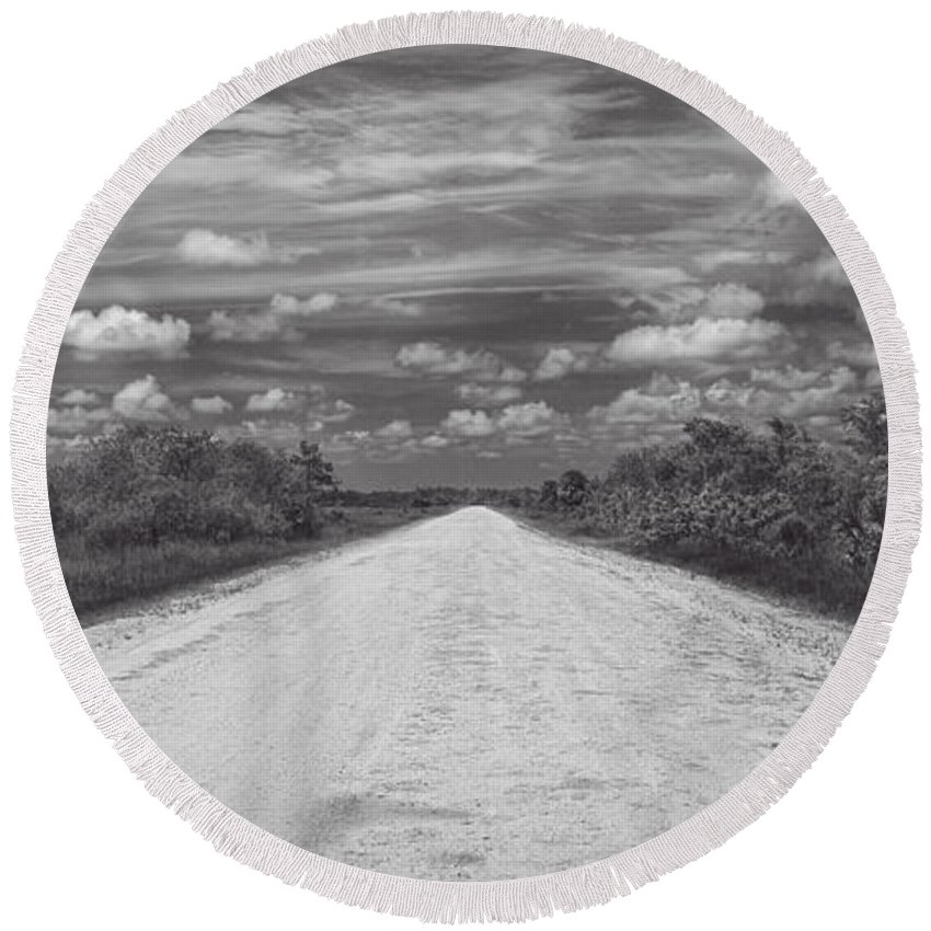 Ahead Round Beach Towel featuring the photograph Wagon Wheel Road Bw by Rudy Umans