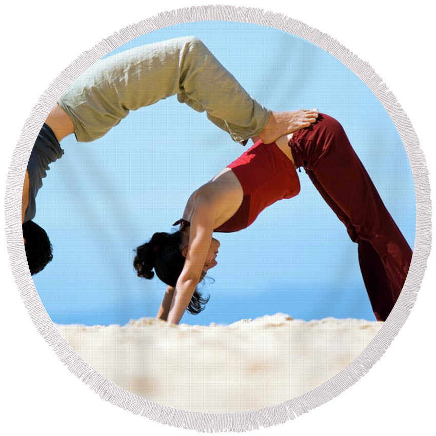 Australia Round Beach Towel featuring the photograph A Man And Woman Practicing Yoga by Lars Schneider