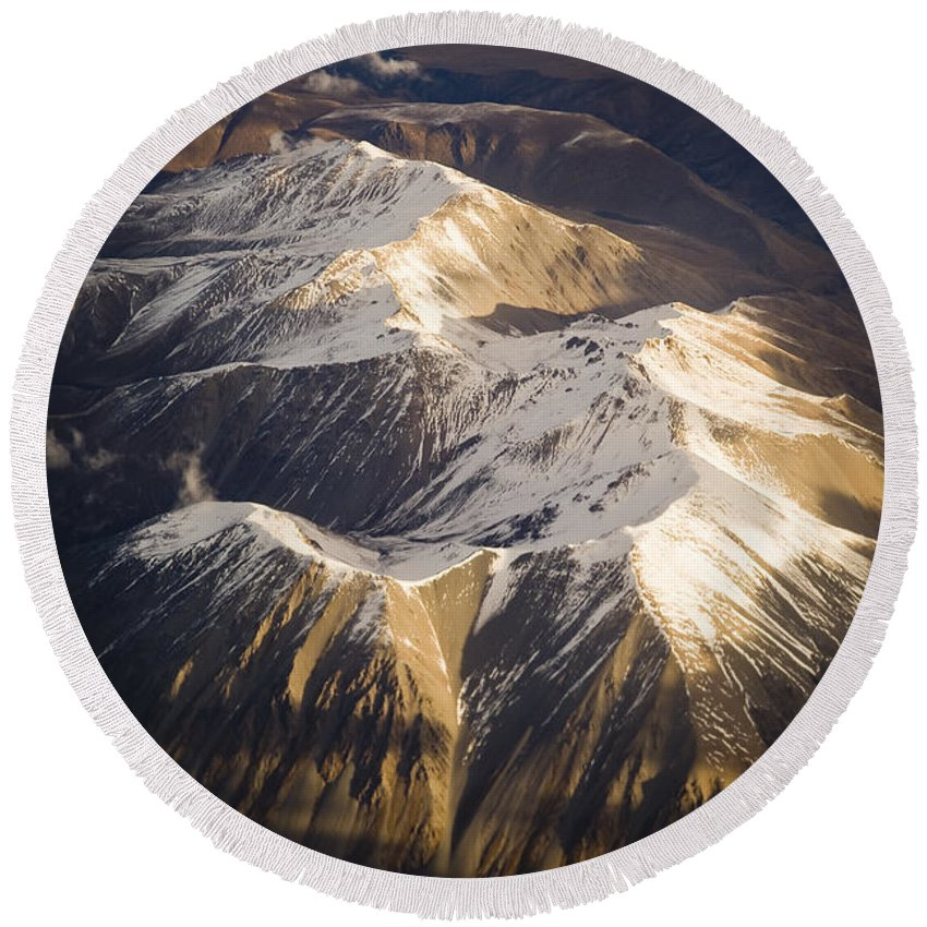 Aspiring Round Beach Towel featuring the photograph Aerial Mountains by Tim Hester