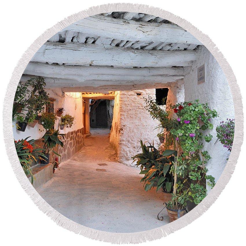 Historic Streets Round Beach Towel featuring the photograph Alpujarras In Granada by Guido Montanes Castillo
