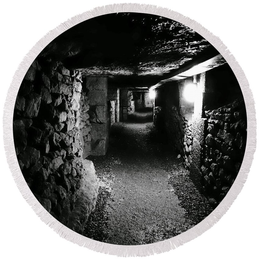Paris Round Beach Towel featuring the photograph A Tunnel In The Catacombs Of Paris France by Richard Rosenshein