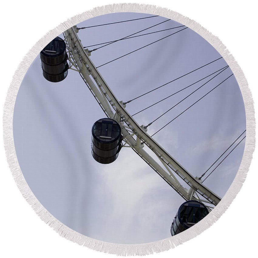 Action Round Beach Towel featuring the photograph 3 Capsules Of The Singapore Flyer Along With The Spokes And Base by Ashish Agarwal