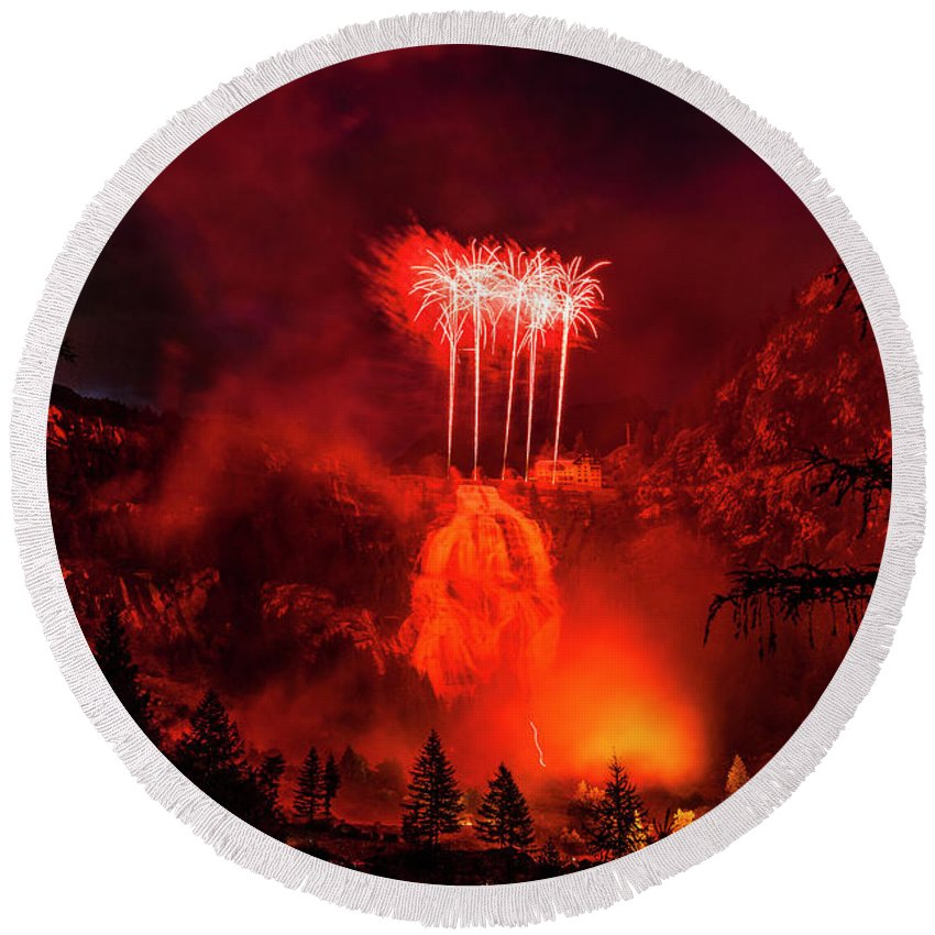 Winter Round Beach Towel featuring the photograph Fireworks Above Toce Falls, Formazza by Paolo Sartori