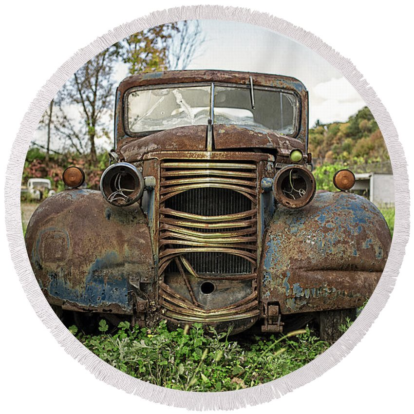 Chevy Round Beach Towel featuring the photograph Old Junker Car by Edward Fielding