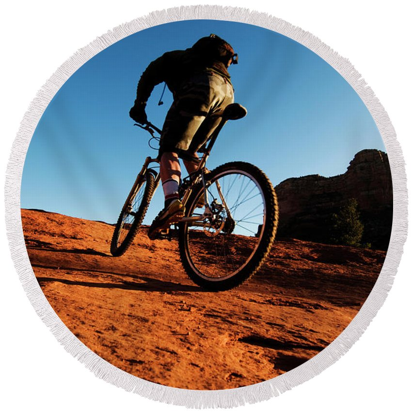Adult Round Beach Towel featuring the photograph A Middle Age Man Rides His Mountain by Kyle George
