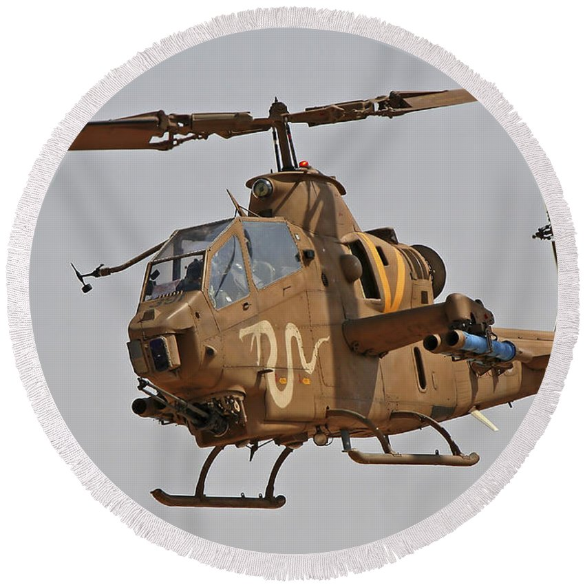 Aircraft Round Beach Towel featuring the photograph An Ah-1s Tzefa Attack Helicopter by Ofer Zidon