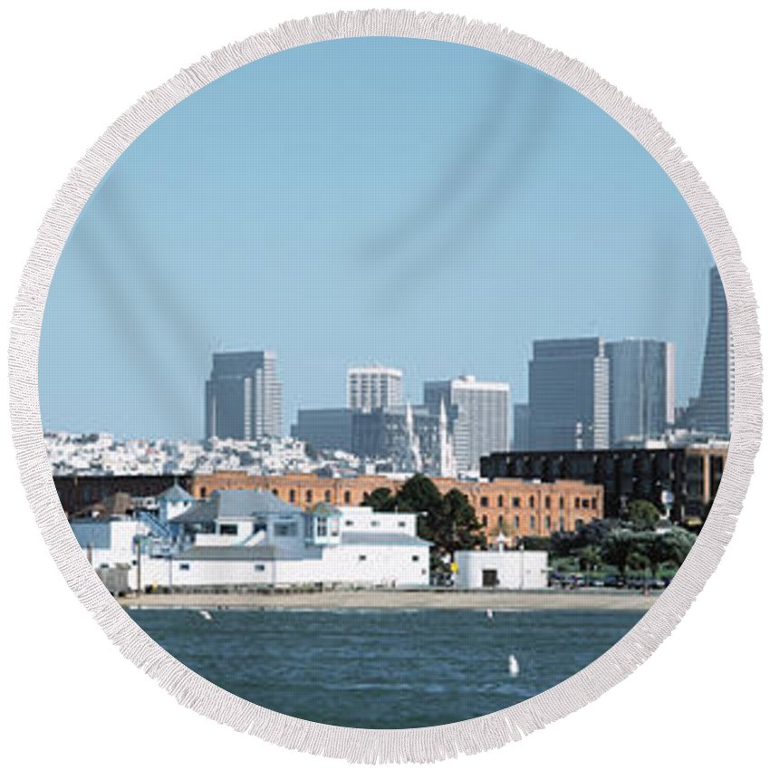 Photography Round Beach Towel featuring the photograph Buildings At The Waterfront, San by Panoramic Images
