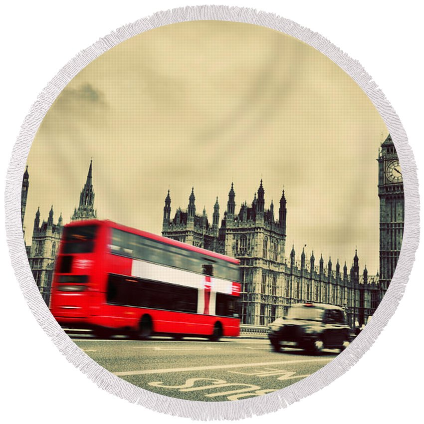 London Round Beach Towel featuring the photograph London Uk Red Bus In Motion And Big Ben by Michal Bednarek