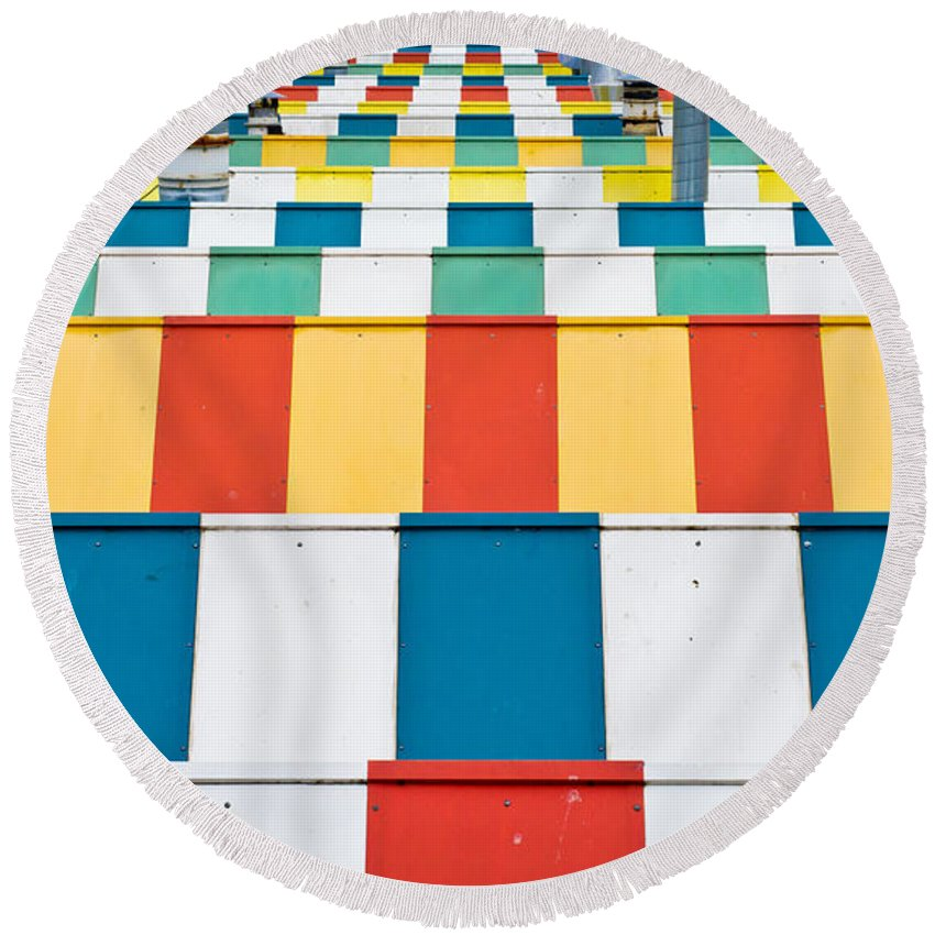 Abstract Round Beach Towel featuring the photograph Colorful Roofs by Tom Gowanlock