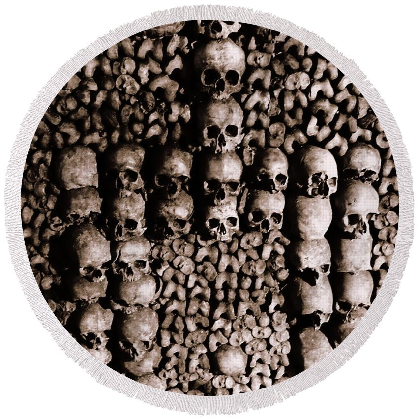 Paris Round Beach Towel featuring the photograph Skulls And Bones In The Catacombs Of Paris France by Richard Rosenshein