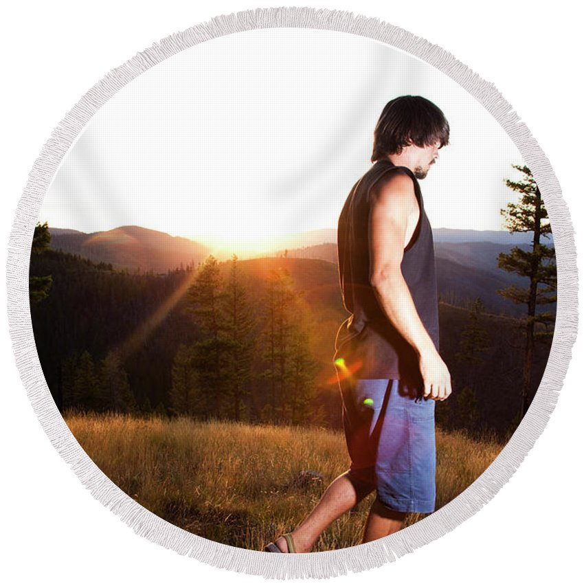 Adult Round Beach Towel featuring the photograph A Professional Slackliner Plays by Jared Alden