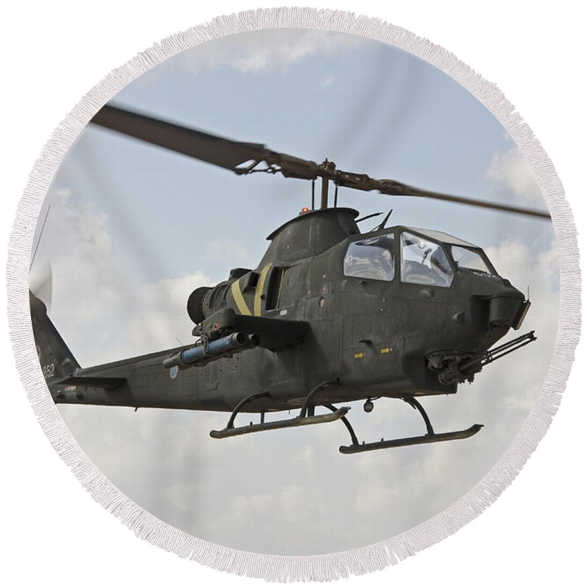 Transportation Round Beach Towel featuring the photograph An Ah-1s Tzefa Attack Helicopter by Ofer Zidon