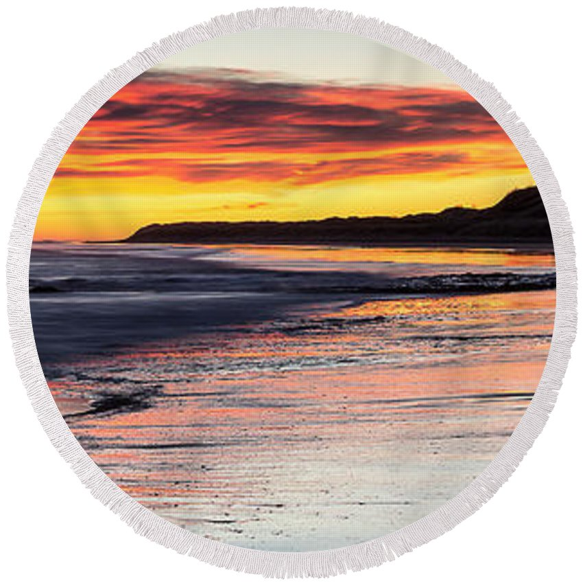 Bamburgh Castle Round Beach Towel featuring the photograph Bamburgh Castle At Sunrise by David Pringle