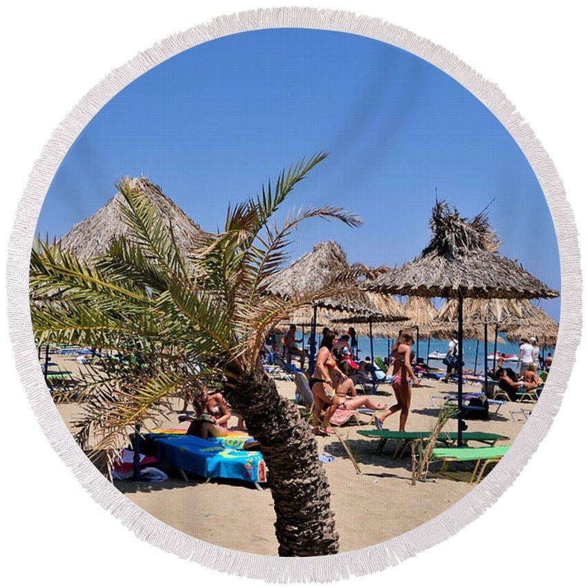 Vai; Lasithi; Lassithi; Beach; Crete; Palms; Trees; Forest; Sand; Kriti; Greece; Hellas; Greek; Hellenic; People; Tourists; Swim; Swimming; Island; Sunbathing; Suntanning; Suntan; Tanning; Relaxing; Relaxation; Sea; Islands; Holidays; Vacation; Travel; Trip; Voyage; Journey; Tourism; Touristic; Summer; Umbrellas; Parasols; Sunshades; Sun Beds; Sea Beds; Blue; Sky Round Beach Towel featuring the photograph Vai Beach by George Atsametakis