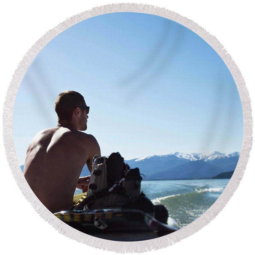 20-24 Years Round Beach Towel featuring the photograph A Athletic Man Sits And Looks by Patrick Orton