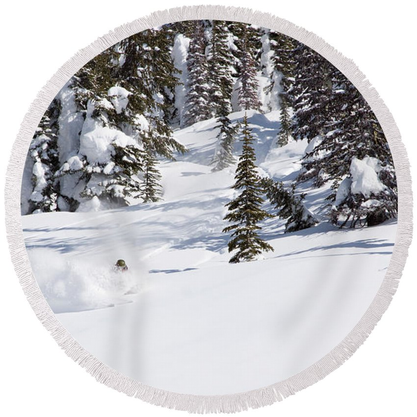 30-34 Years Round Beach Towel featuring the photograph A Backcountry Skier A Turn Near Ymir by Craig Moore