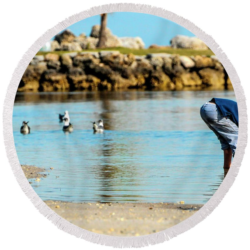 Childhood Round Beach Towel featuring the photograph A Boy Searches The Water At Matheson by Molly Steinwald