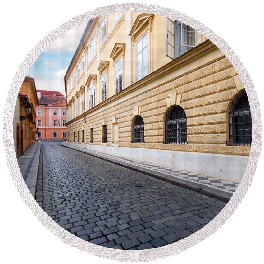 Architecture Round Beach Towel featuring the photograph A Charming Street In Prague by Michal Bednarek