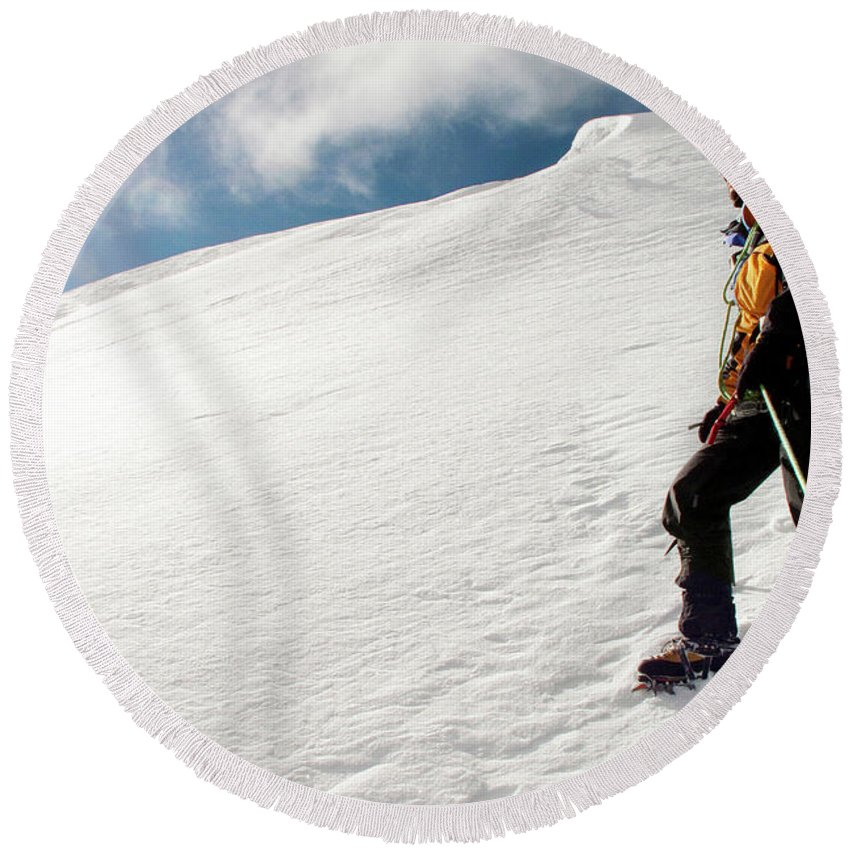 30-34 Years Round Beach Towel featuring the photograph A Climber On The Glacier Of Cotopaxi by Caroline Bennett