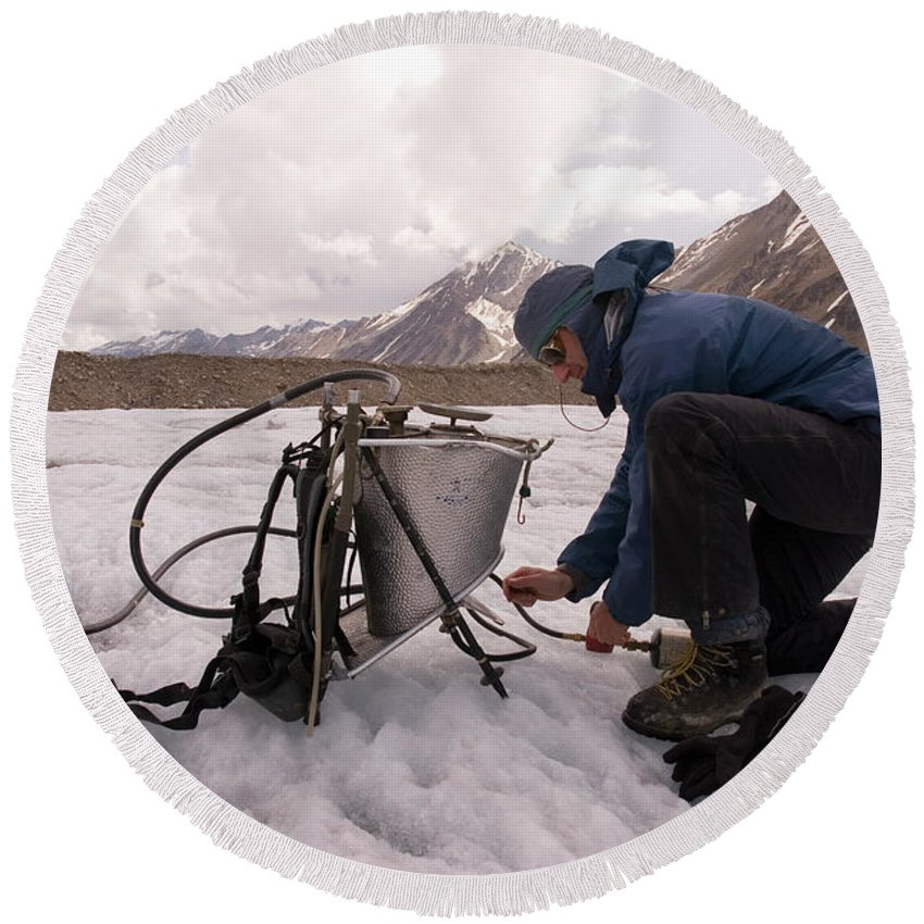 Adult Round Beach Towel featuring the photograph A Glaciologist Tinkers With A Steam by Dan Shugar